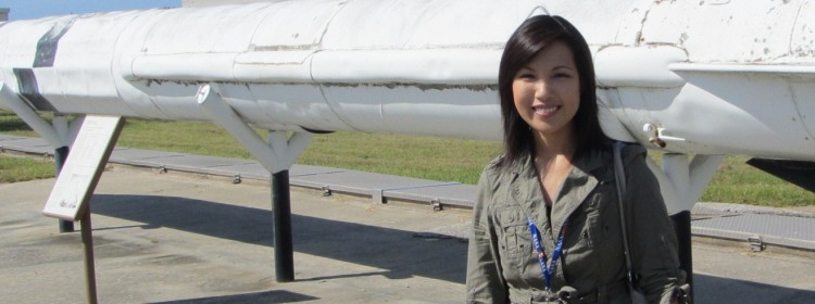 Su-Yin Tan standing beside a rocket.