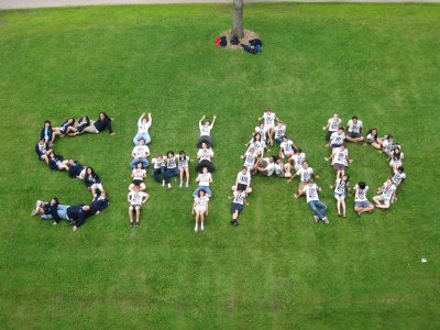 Students spell out the word SHAD with their bodies