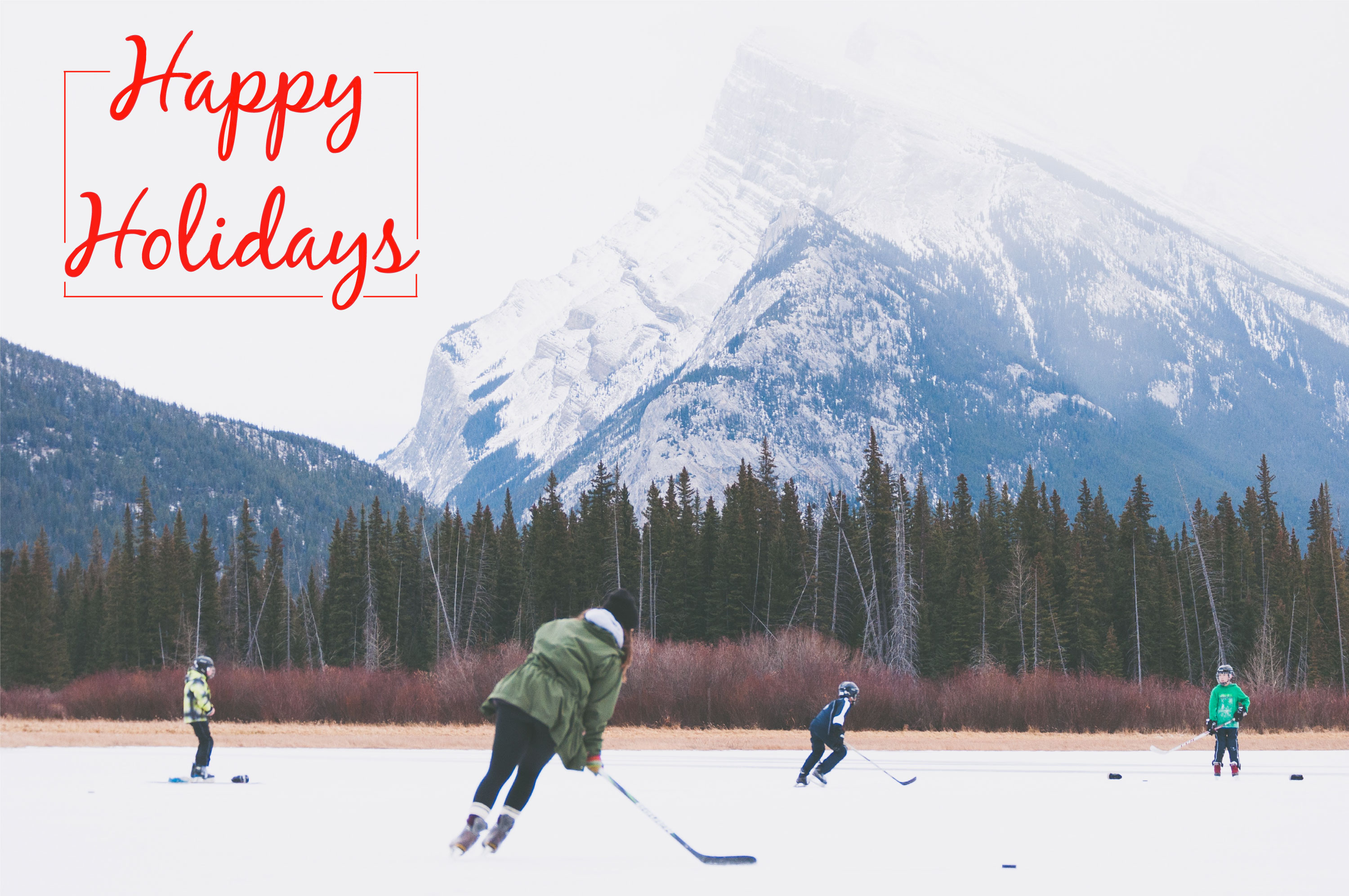 "People skating on lake at foot of mountain, with caption: ""happy holidays"""