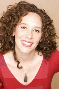 Tzeporah Berman in a red shirt smiling politely