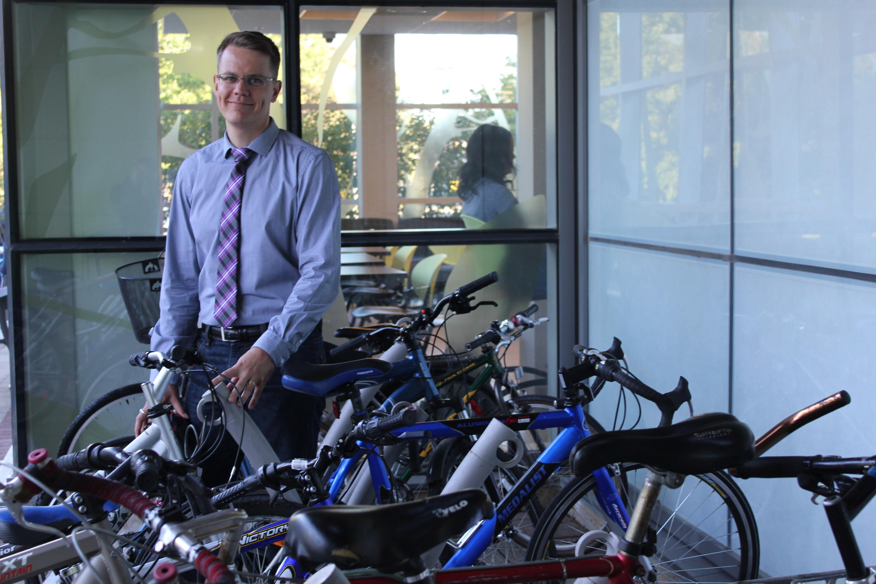 Markus standing with bikes