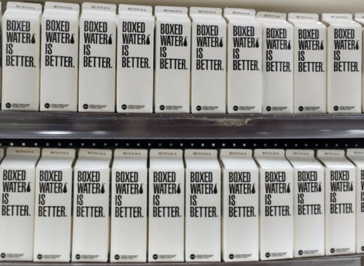 "Rows of cartons labeled ""Boxed water is better"""