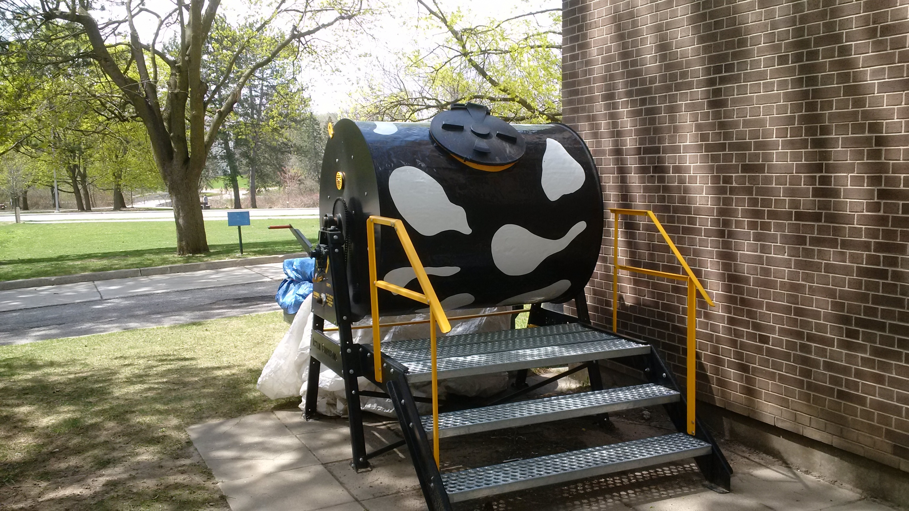Compost bin painted as a cow
