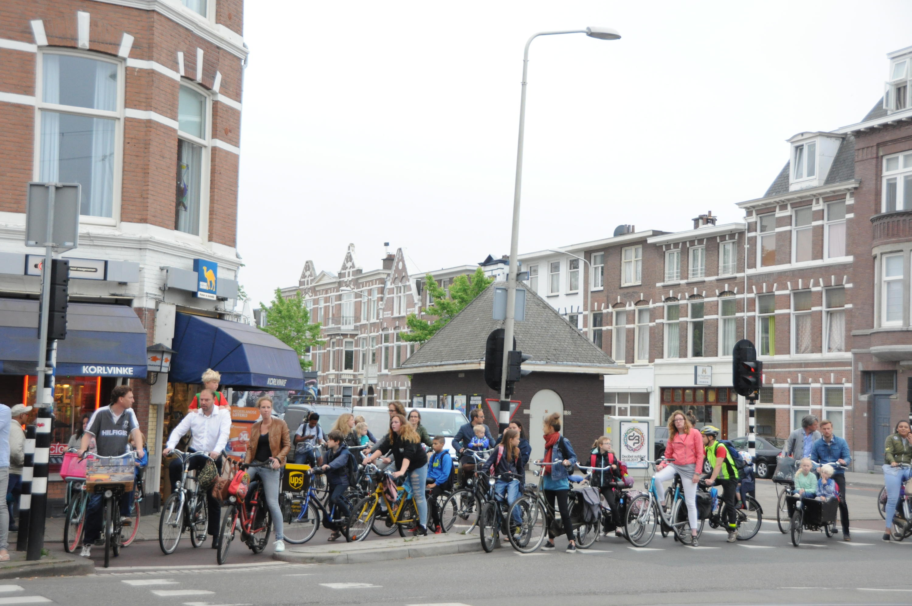 A group of people riding bicycles on the street