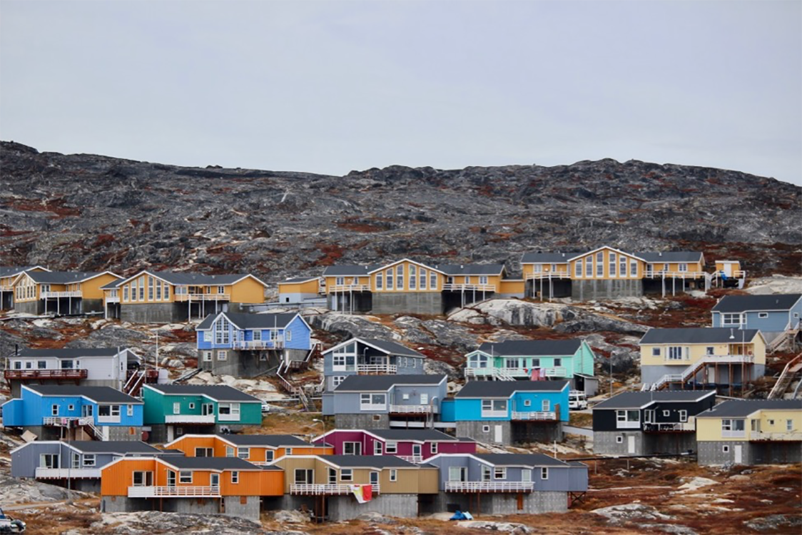 Colorful houses on cliff in Ilulissat, Greenland