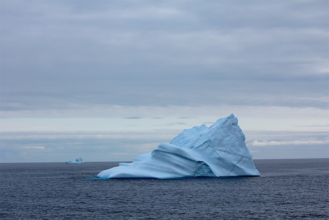 Icebergs most likely from Greenland's ocean-terminating glaciers. This specific one was so large, it was grounded on the ocean's