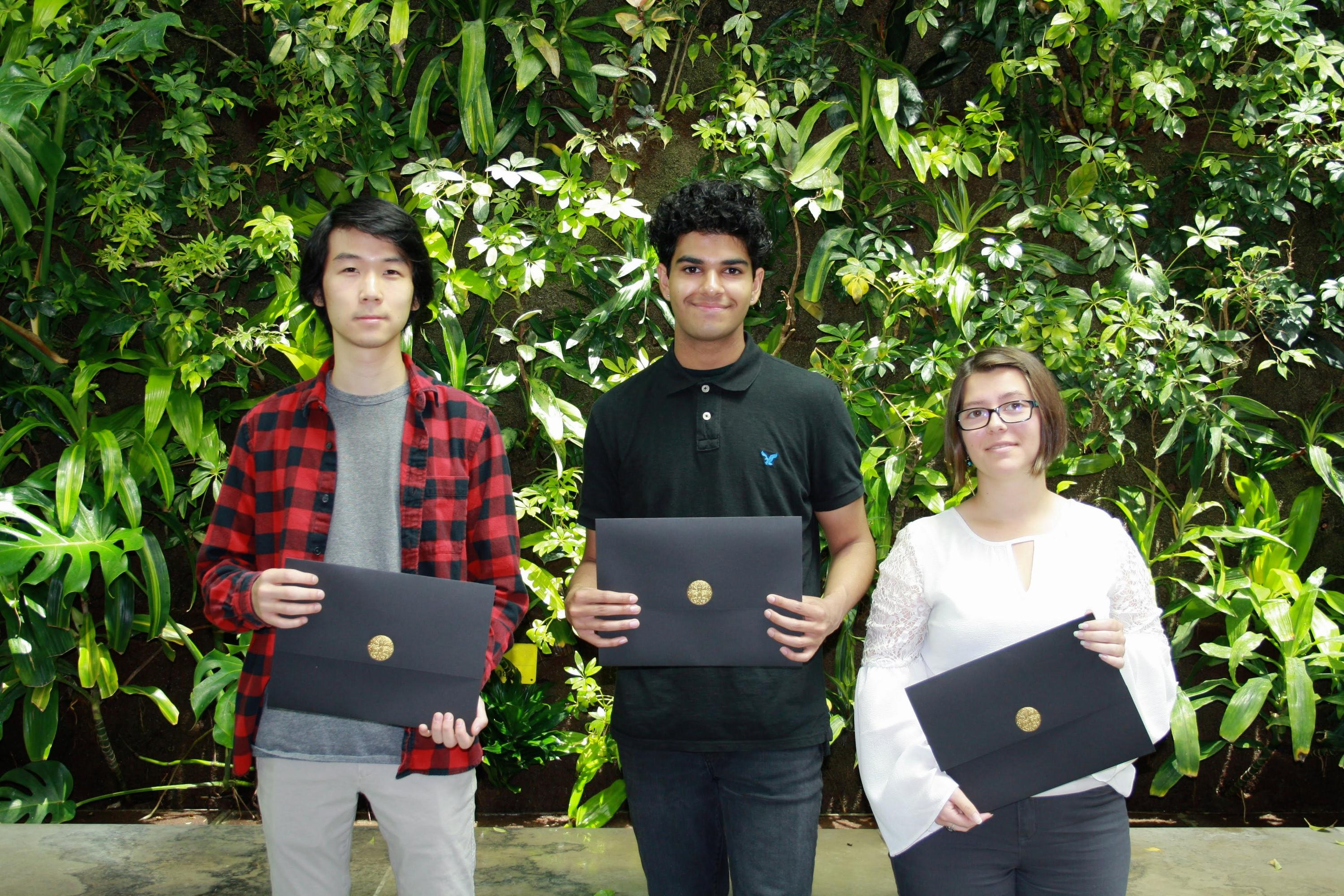 Anton Yu, Nikhail Dawan, and Jennifer Fliesser holding their certificates