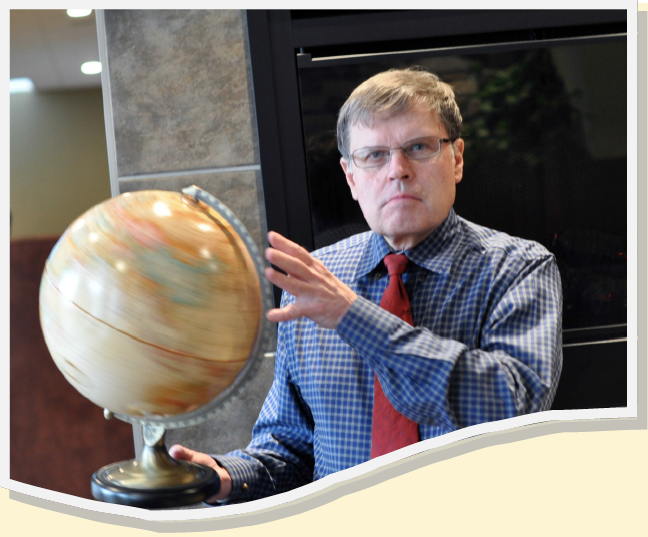 Larry Smith Spinning a Globe