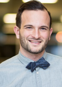 Young man with blue shirt and bow tie