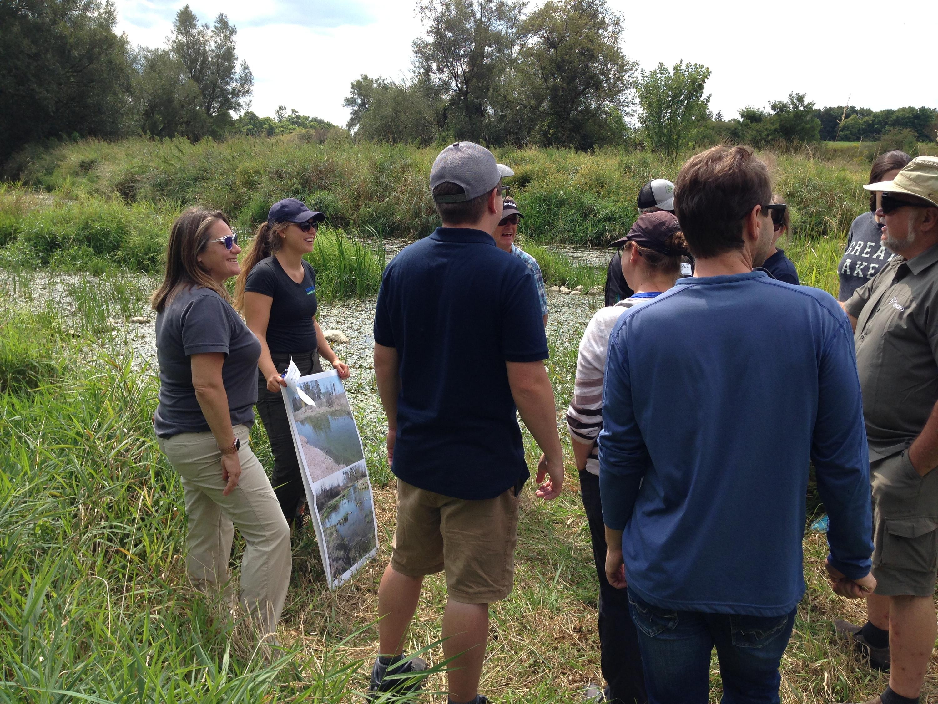 Merrin Macrae and a team of students looking at a field