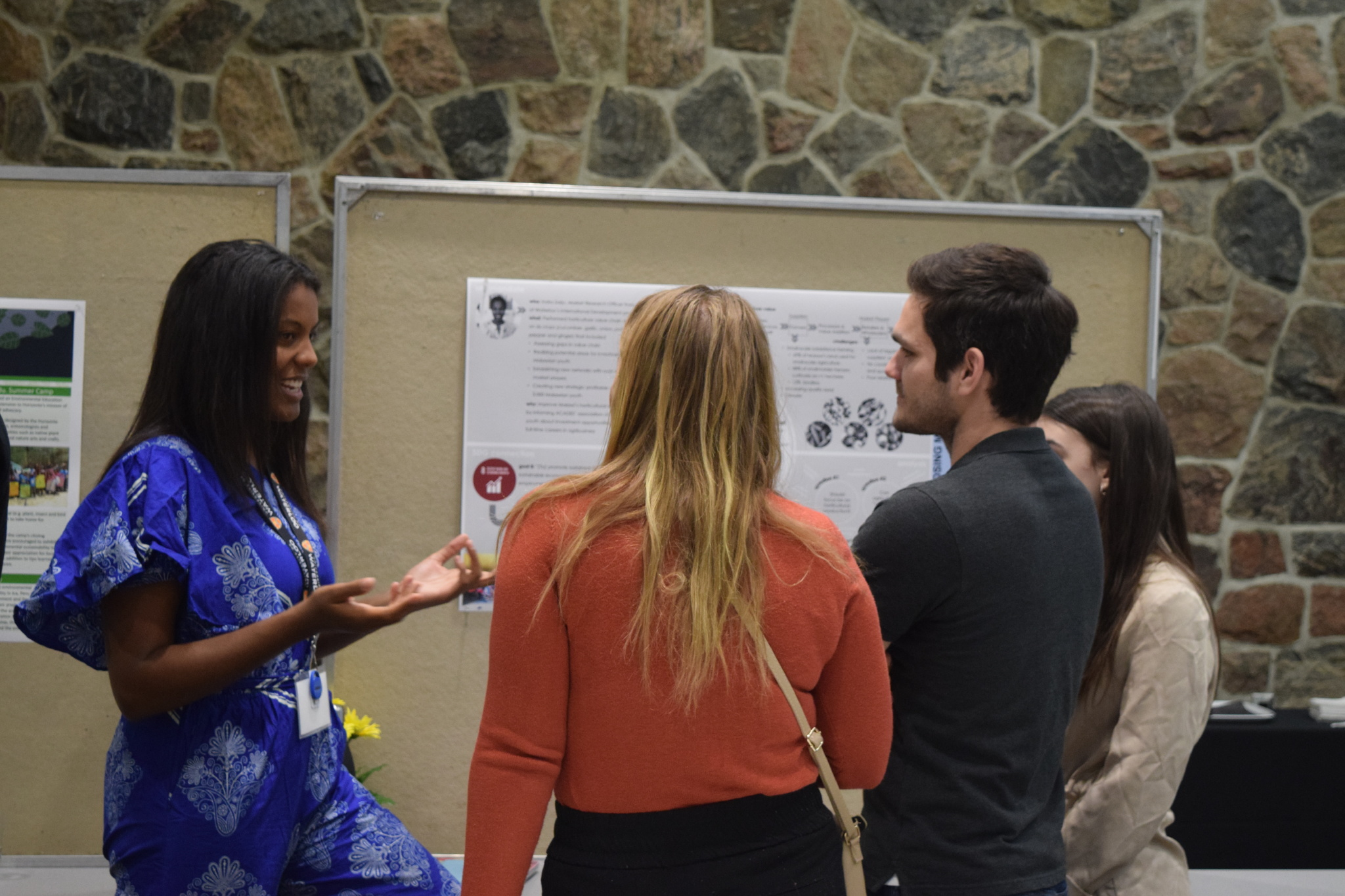 International Development students consider a poster during the capstone event