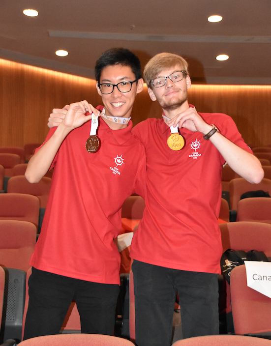 Andrew Ding and Ben Woodward posing with their medals