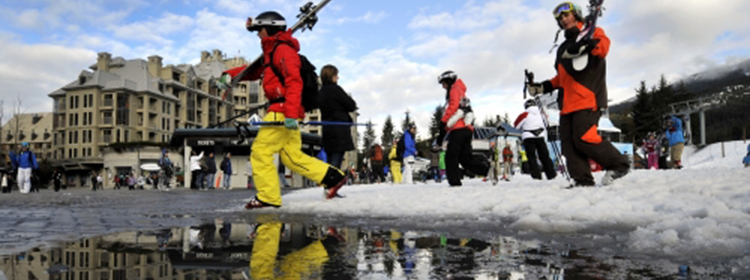 skiiers near a puddle of water