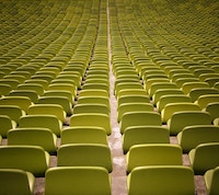 Lecture hall of green chair lined up