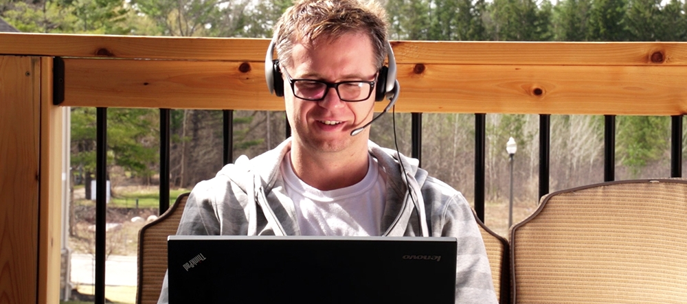 Man studying outdoors on a laptop