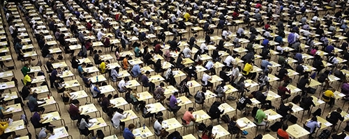 Students writing exams on-campus