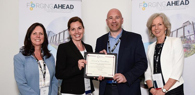 Marie Lippins, Aldo Caputo and CAUCE Executives with the award