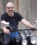 Professor Doug Cowan on a motorcycle