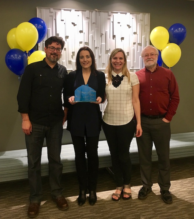 Robert Case, Kristina Llewellyn, Christine Logel, and Daniel Bratton accepting the FAUW Appreciation Award for the Renison Association of Academic Staff executive.