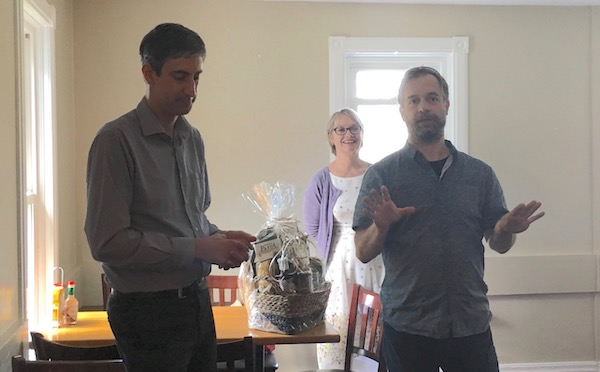 Benoit Charbonneau accepting a gift from members of the Lecturers Committee, presented by chair Paul Wehr and Cynthia Tremblay.