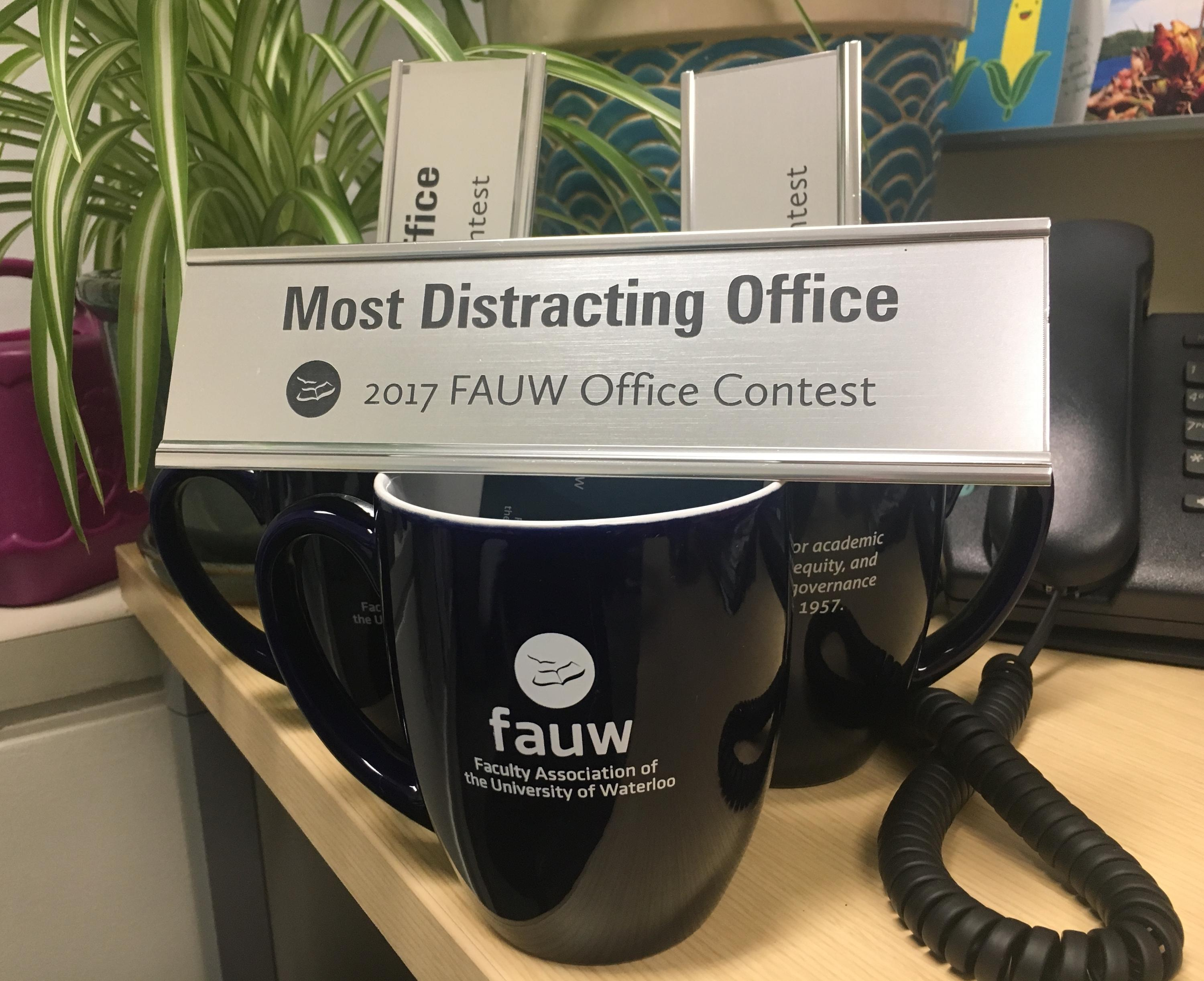 "an example office contest prize: the ""Most Distracting Office"" nameplate"