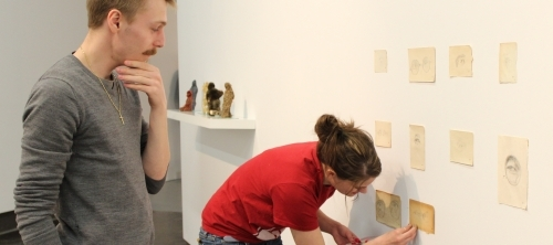 Students installing an exhibition