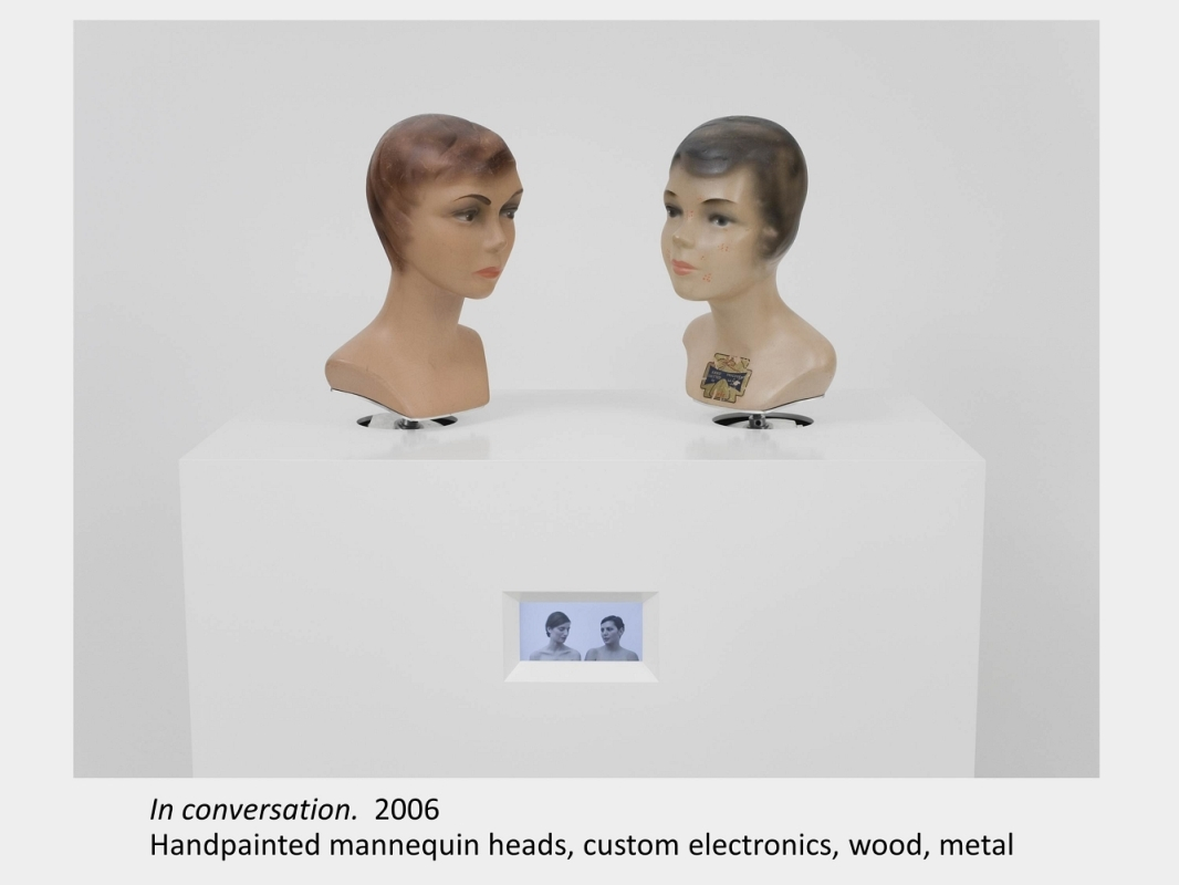 Artwork by Lois Andison. In conversation. 2006. Handpainted mannequin heads, custom electronics, wood, metal