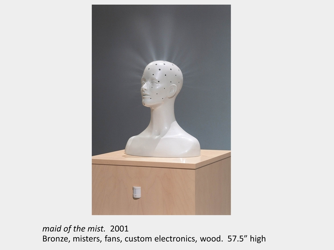 """Artwork by Lois Andison. Maid of the mist.  2001. Bronze, misters, fans, custom electronics, wood.  57.5"""" high"""