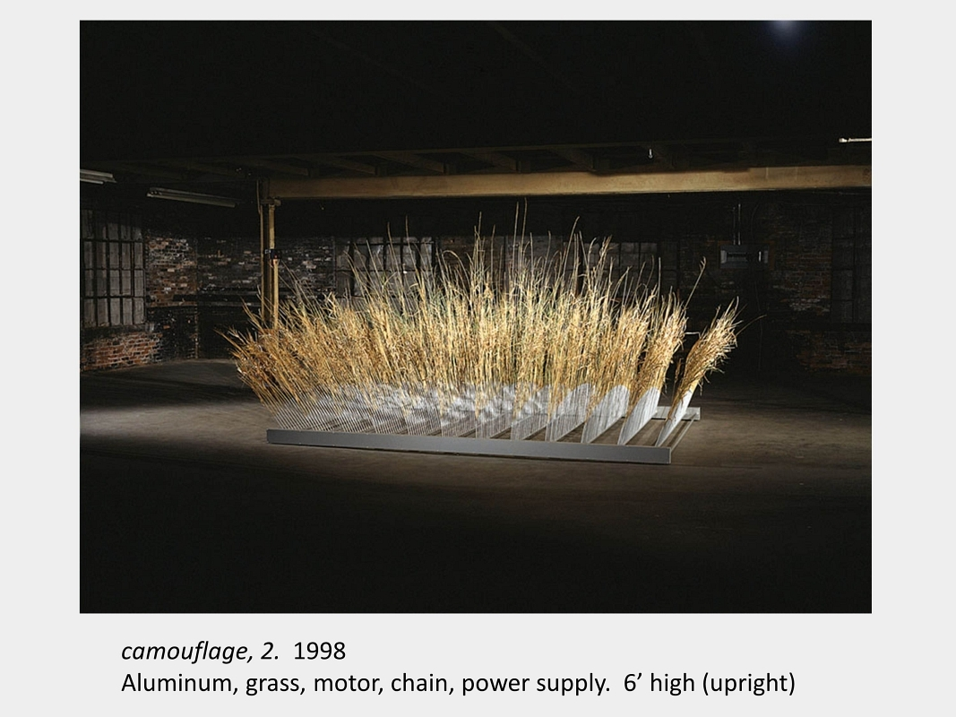 Artwork by Lois Andison. Camouflage, 2. 1998. Aluminum, grass, motor, chain, power supply.  6' high (upright)