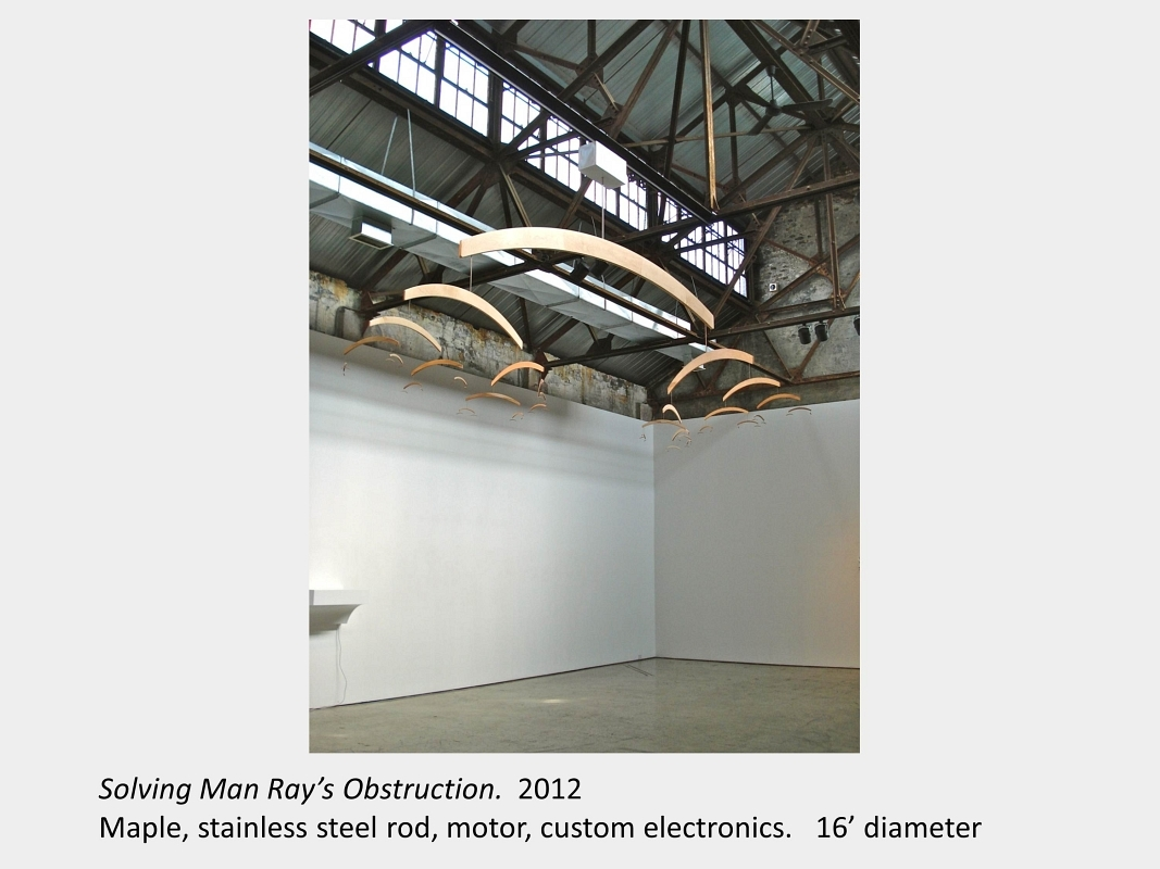 Artwork by Lois Andison. Solving Man Ray's Obstruction. 2012. Maple, stainless steel rod, motor, custom electronics.  16' dia.