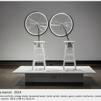 Artwork by Lois Andison.  nudging marcel.  2014, Bicycle wheels and forks, vintage stools, lacquered wood, metal, acrylic, motor