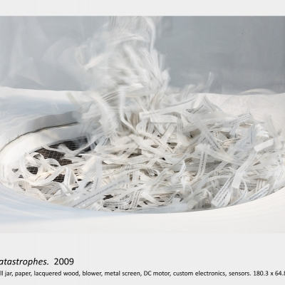 Artwork by Lois Andison.   1,000 catastrophes.  2009, Antique bell jar, paper, lacquered wood, blower, metal screen, DC motor