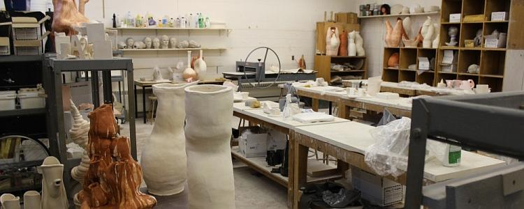 The ceramics studio in East Campus Hall with student assignments.
