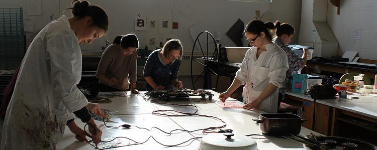 Students participating in an encaustic painting workshop in the print studio.