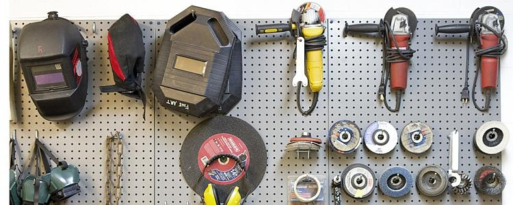 Tools and safety equipment hanging on the wall in the metal workshop in East Campus Hall.