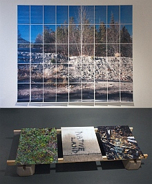 Gallery installation; on wall - landscape composed of pages in grid of 9 by 5, on floor 3 photos - centre one reads Native Land