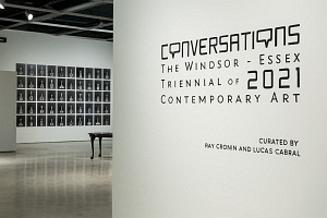 View of art gallery installation, wall label reads Conversations Windsor Essex Triennial of 2021 Contemporary Art