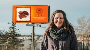 Emily Bickell and her Reese Peanut Butter Cup billboard