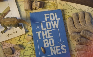 Book cover titled Follow the Bones with a map, work gloves and a dinosaur figurine
