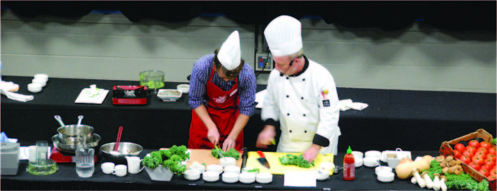 A student and a chef cooking together