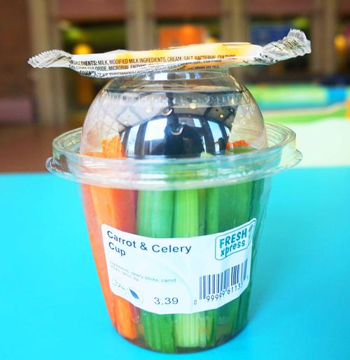 Carrot and celery cup with a slice of cheese