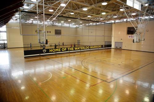 CIF gym with sign that says home of the waterloo warriors