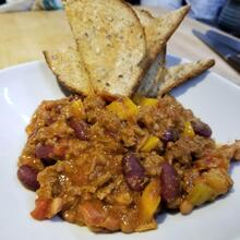 Chili plate with bread on the side