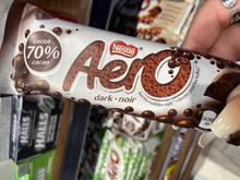 Person holding Aero dark chocolate bar