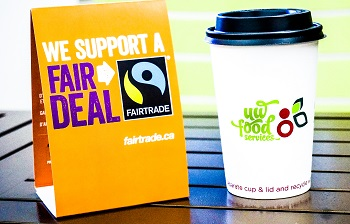 Fairtrade coffee with poster that has logo
