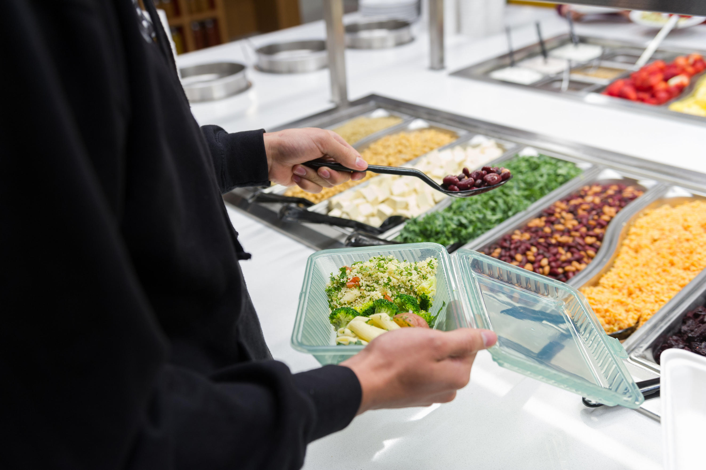 Student filling eco-container with food