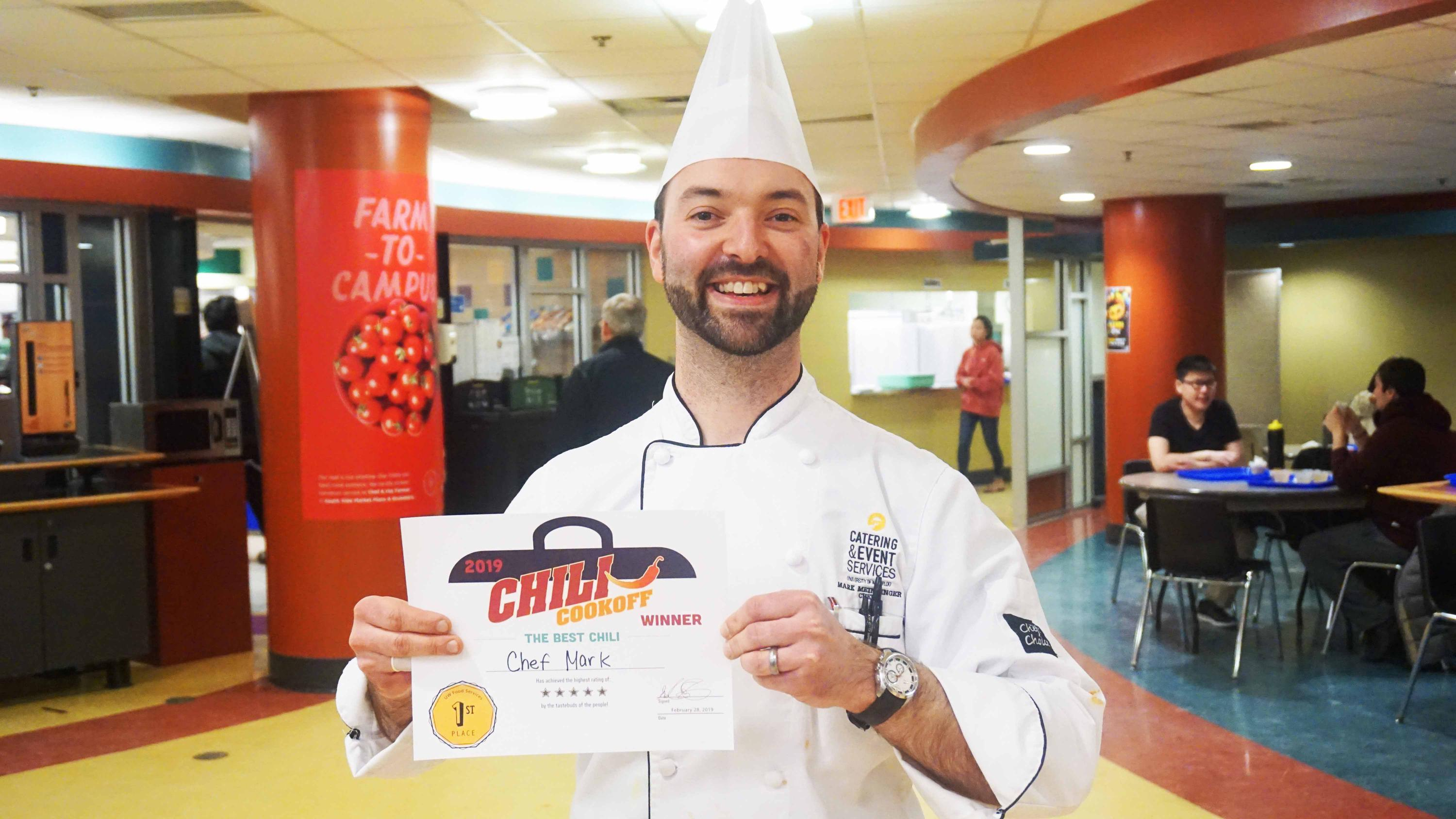 Chef holding certificate
