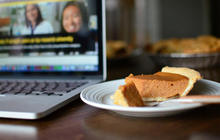 slice of pie sitting on desk with a laptop beside it