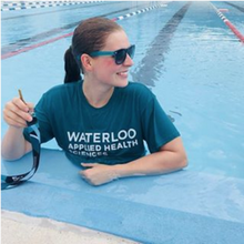 student in pool wearing an Applied Health Sciences t-shirt