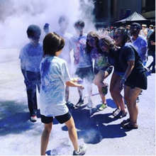 students at Faculty of Engineering orientation with purple smoke in the air